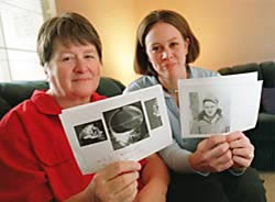 Photo: Linda Holmquist Darrach, left, and her daughter, Crystal Alexander, both of Folsom, hold photos of Darrach's father, Sgt. Harold D. Holmquist, and a ring he was wearing when he was shot down in Italy in World War II.